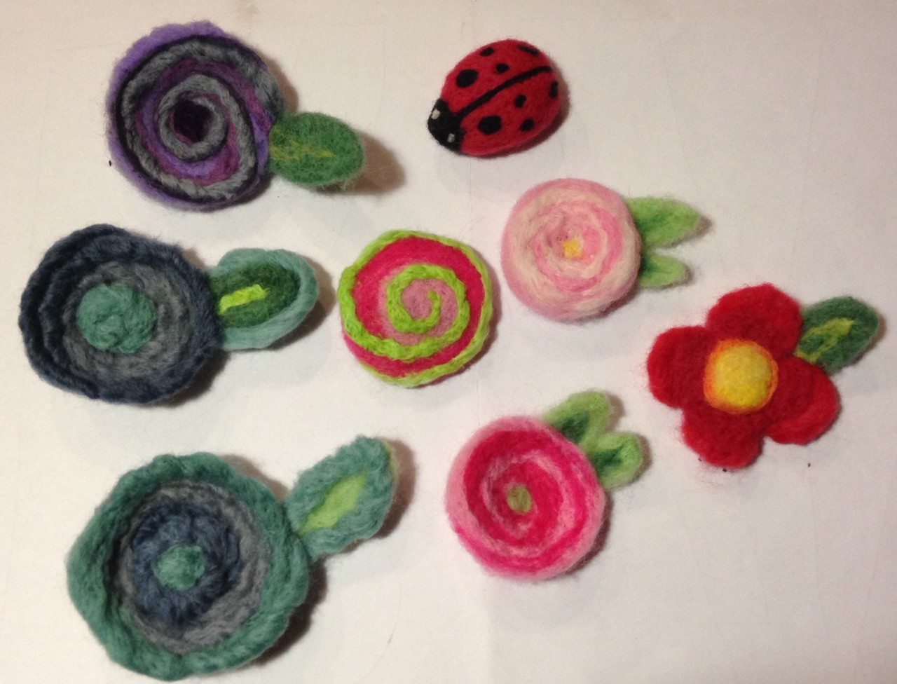 Lots of felted Brooches
